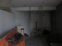 Este centro Stabile con Negozio e Appartamento