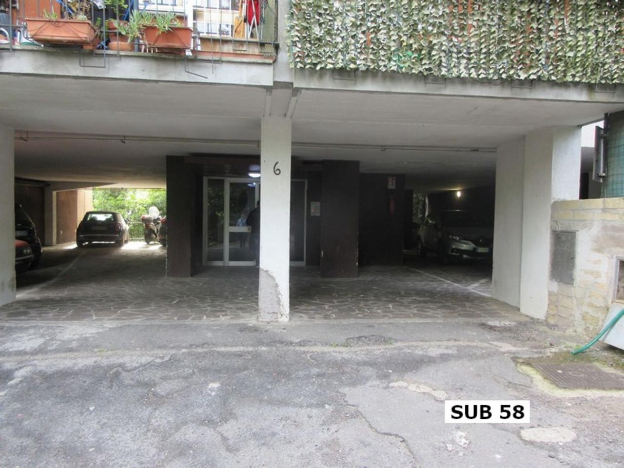 Posto auto coperto al piano terra (sub 58)